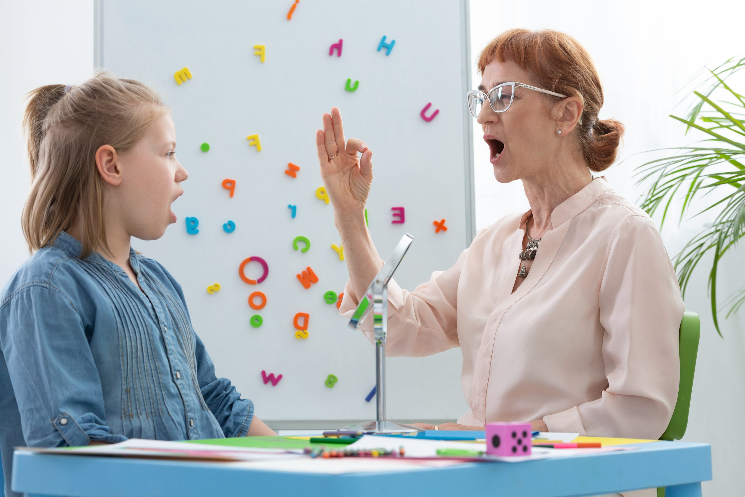 Therapist Teaching Short and Long Vowel Sounds